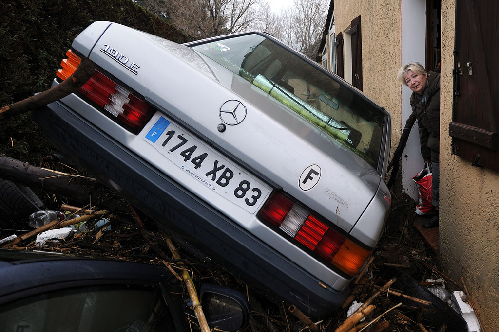 """. A car is blocked in front of a house on Januray 20, 2014 in La Londe-les-Maures, southeastern France. River levels were receding early today in southeastern France after \""""historic\"""" floods left two people dead and more than 150 were airlifted to safety. A third man disappeared while out on his boat and 4,000 homes have been left without power after the deluge in the department of Var, they said. Local official Laurent Cayrel said one of the victims, a 73-year-old man, died in his basement, while the other was swept away in his car.  AFP PHOTO / BORIS HORVATBORIS HORVAT/AFP/Getty Images"""