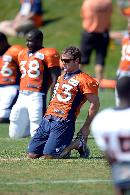 . Denver Broncos wide receiver Wes Welker (83) stretches duirng practice August 20, 2013 at Dove Valley. Welker did not practice with the team. (Photo by John Leyba/The Denver Post)