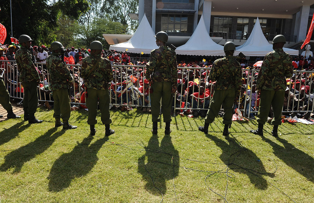 . Kenyan soldiers are deployed in front of supporters of Kenyan presidential candidate Uhuru Kenyatta at the Catholic University where Uhuru Kenyatta gave the acceptance speech of his victory in Kenya\'s national elections on March 9, 2013 in Nairobi.   AFP PHOTO / Jennifer Huxta/AFP/Getty Images