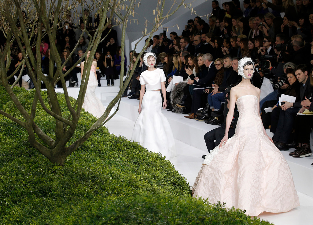 . Models present creations by Raf Simons for Christian Dior\'s Spring Summer 2013 Haute Couture fashion collection, presented in Paris, Monday, Jan.21, 2013. (AP Photo/Christophe Ena)