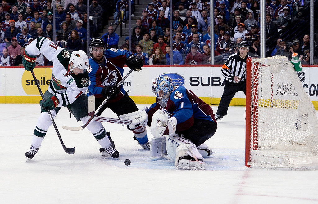 . Colorado Avalanche goalie Semyon Varlamov (1) keeps his eye on the puck as Minnesota Wild left wing Zach Parise (11) and Colorado Avalanche defenseman Nate Guenin (5) battle for it during the second period.   (Photo by John Leyba/The Denver Post)