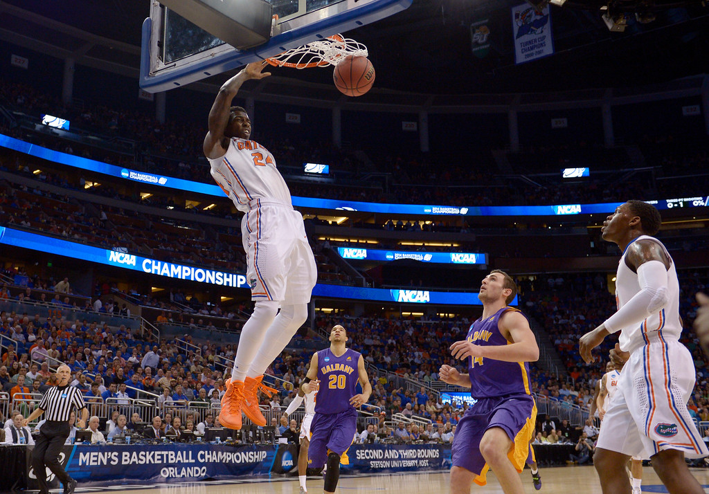 . Florida forward Casey Prather (24) dunks the ball during the first half of a second-round game against Albany in the NCAA college basketball tournament on Thursday, March 20, 2014, in Orlando, Fla. (AP Photo/Phelan M. Ebenhack)