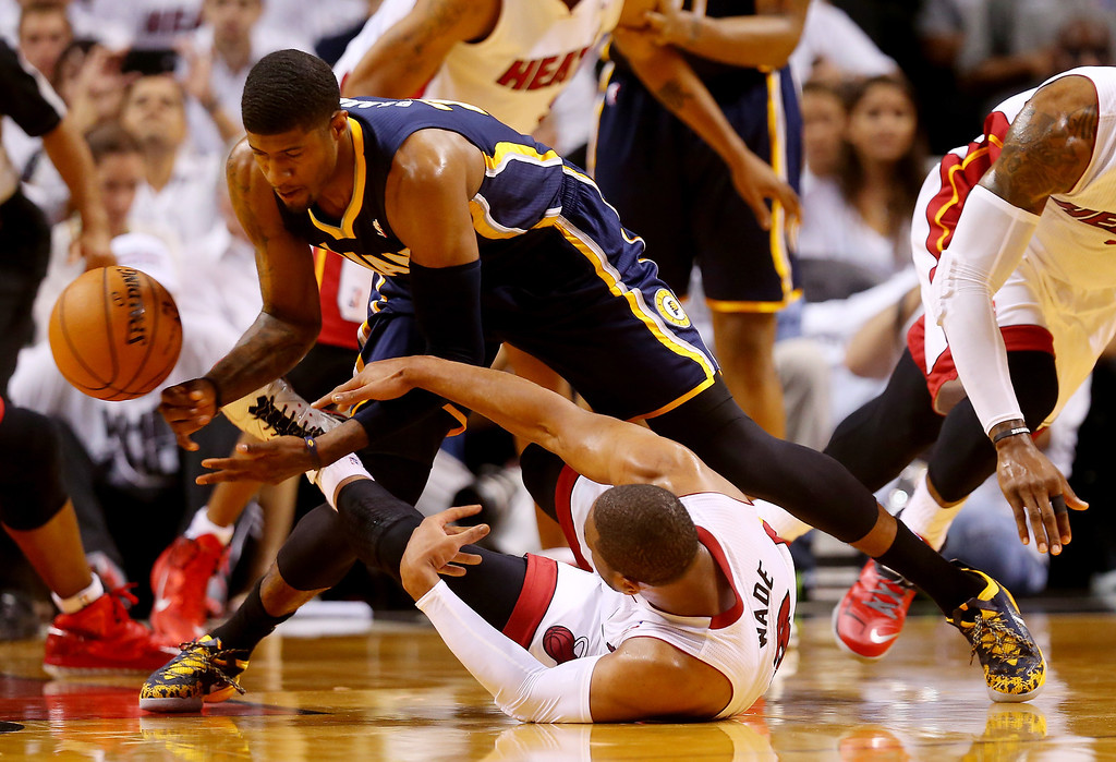 . Paul George #24 of the Indiana Pacers and Dwyane Wade #3 of the Miami Heat battle for a loose ball during Game Four of the Eastern Conference Finals of the 2014 NBA Playoffs at American Airlines Arena on May 26, 2014 in Miami, Florida.  (Photo by Mike Ehrmann/Getty Images)