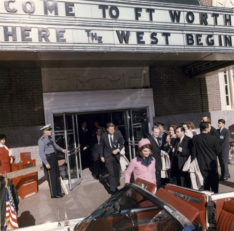 . The president and first lady exit the Hotel Texas after the Fort Worth Chamber of Commerce breakfast. They would soon depart for the short trip to Dallas. Cecil Stoughton/John F. Kennedy Presidential Library and Museum