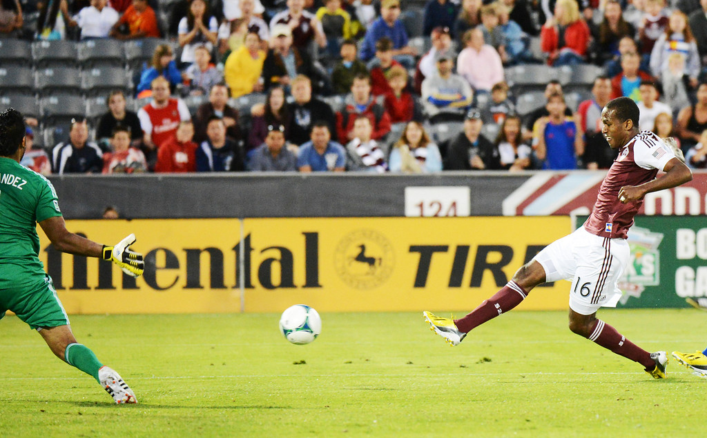. COMMERCE CITY, CO. - June 01: Atiba Harris of Colorado Rapids (16) makes a goal from Raul Fernandez of FC Dallas (1) in the 2nd half of the game at Dick\'s Sporting Goods Park. Commerce City, Colorado. June 1, 2013. Game tied 2-2. (Photo By Hyoung Chang/The Denver Post)