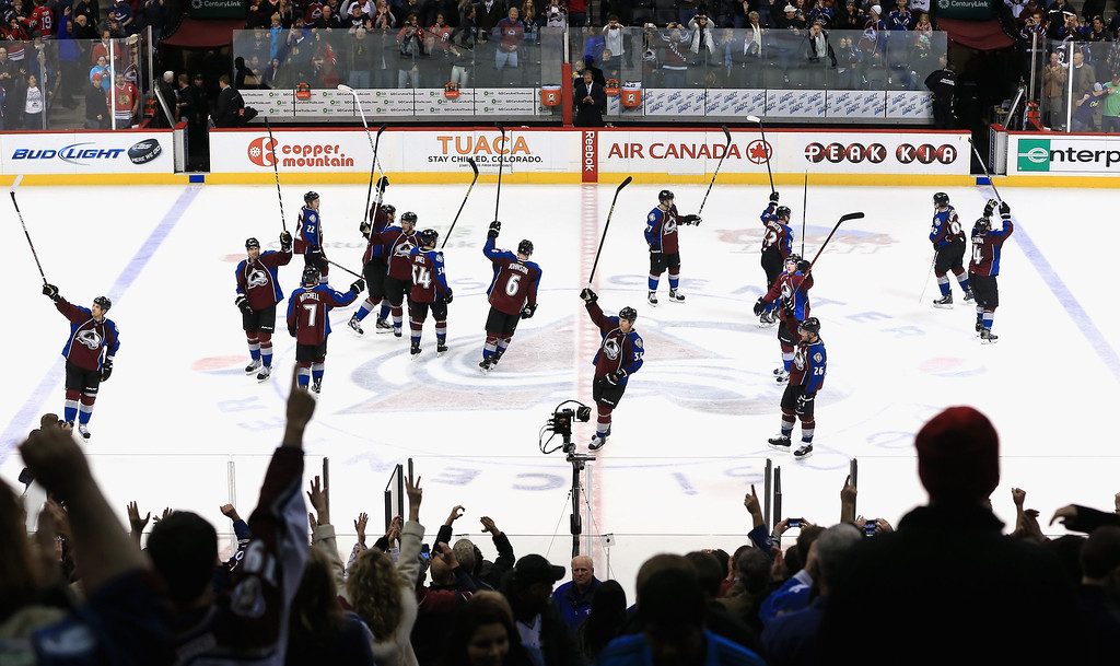 . DENVER, CO - MARCH 08:  The Colorado Avalanche celebrate their victory over the Chicago Blackhawks at the Pepsi Center on March 8, 2013 in Denver, Colorado. The Avalanche won 6-2 to end the Blackhawks 30 game undefeated streak.  (Photo by Doug Pensinger/Getty Images)