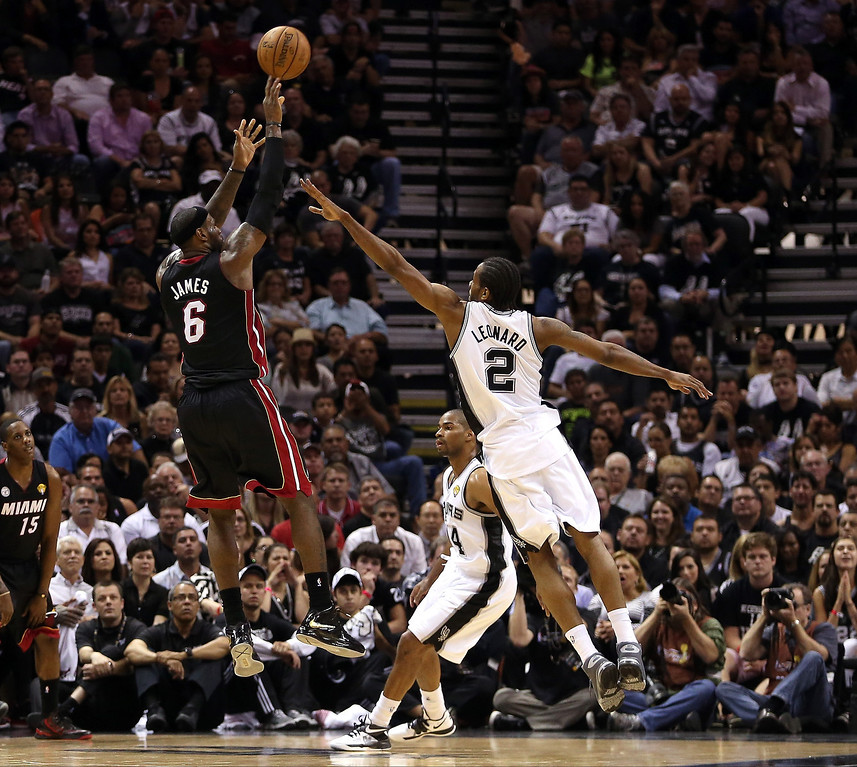 . LeBron James #6 of the Miami Heat shoots over Kawhi Leonard #2 of the San Antonio Spurs in the second quarter during Game Four of the 2013 NBA Finals at the AT&T Center on June 13, 2013 in San Antonio, Texas.  (Photo by Christian Petersen/Getty Images)