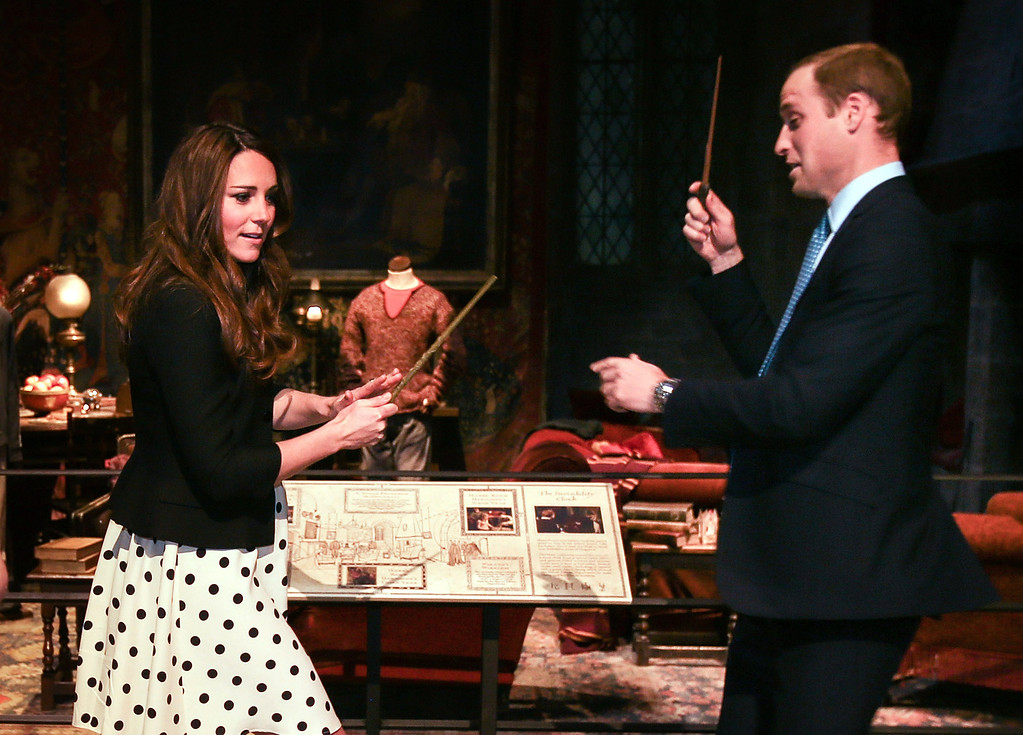. Catherine, Duchess of Cambridge and Prince William, Duke of Cambridge pretend to challenge each other with their wands during the Inauguration Of Warner Bros. Studios Leavesden on April 26, 2013 in London, England.  (Photo by Paul Rogers - WPA Pool/Getty Images)