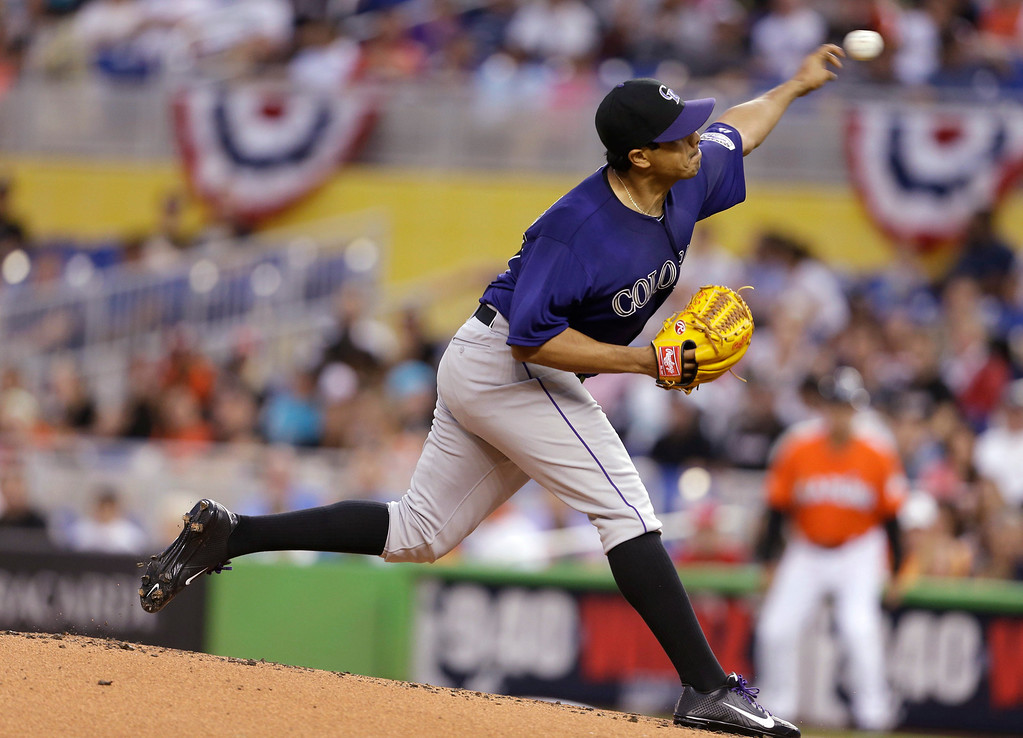 . Colorado Rockies starting pitcher Jorge De La Rosa throws during the first inning of an opening day baseball game against the Miami Marlins, Monday, March 31, 2014, in Miami. (AP Photo/Lynne Sladky)