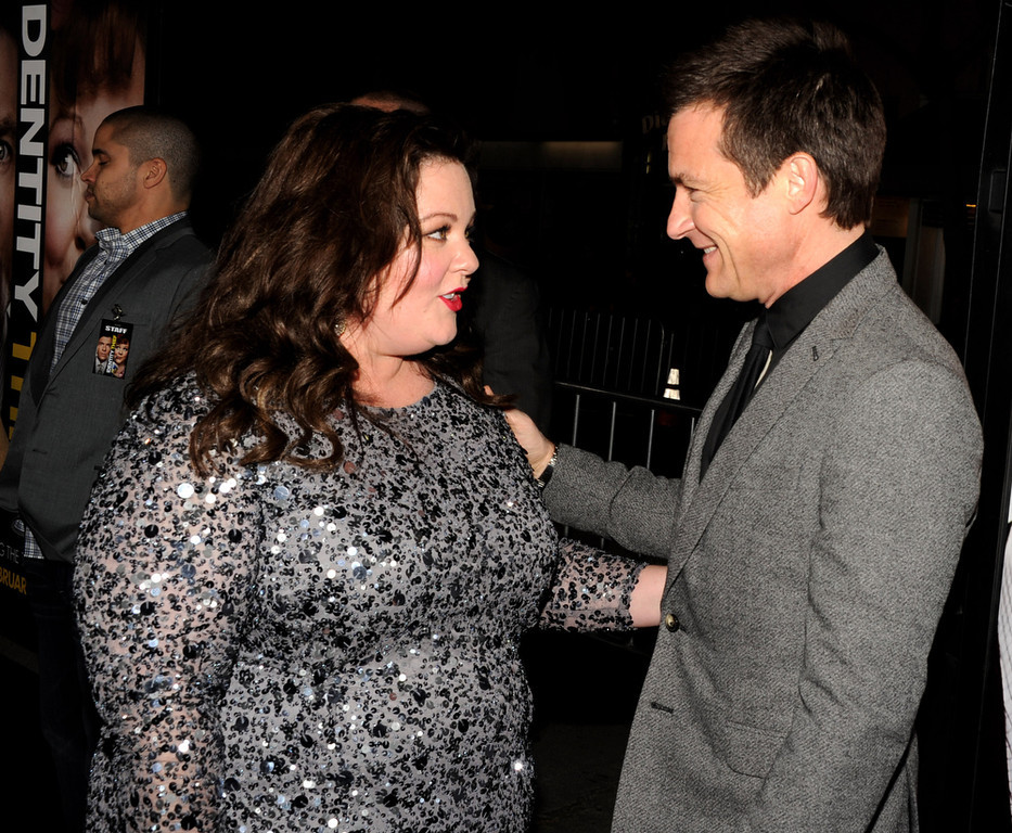 """. Actors Melissa McCarthy (L) and Jason Bateman arrive at the premiere of Universal Pictures\' \""""Identity Theft\"""" at the Village Theatre on February 4, 2013 in Los Angeles, California.  (Photo by Kevin Winter/Getty Images)"""