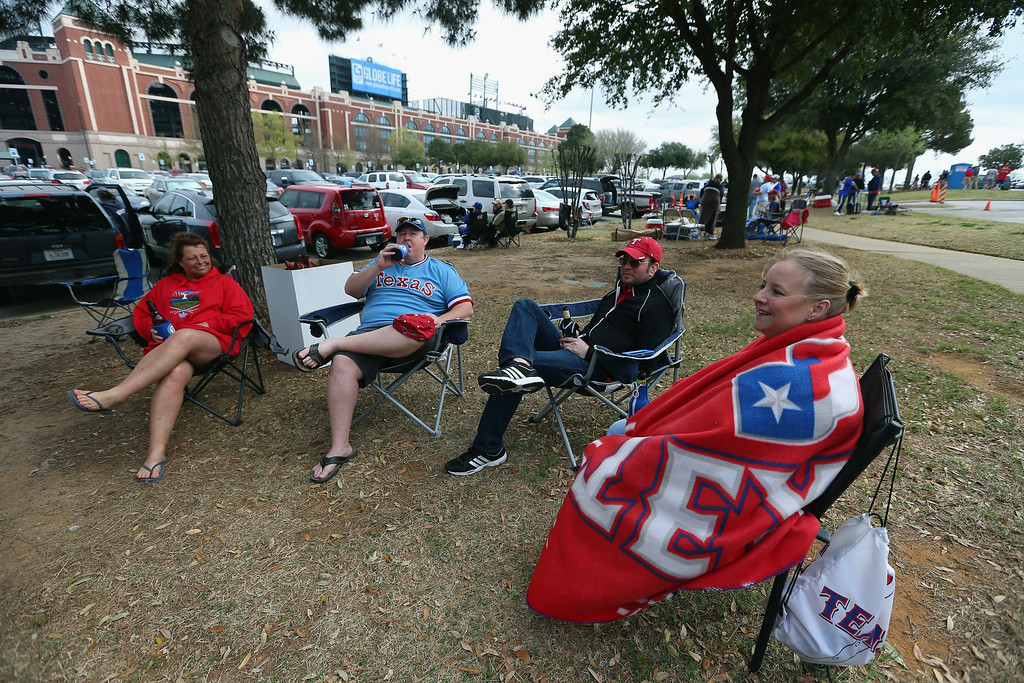 . Fans tailgate before the MLB Opening Day game between the Philadelphia Phillies and the Texas Rangers at Globe Life Park in Arlington on March 31, 2014 in Arlington, Texas.  (Photo by Ronald Martinez/Getty Images)