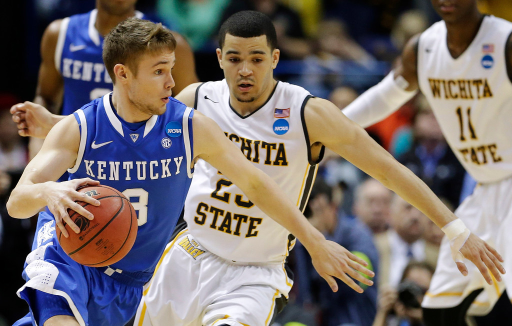 . Kentucky guard Jarrod Polson (3) drives past Wichita State guard Fred VanVleet (23) during the first half of a third-round game of the NCAA college basketball tournament Sunday, March 23, 2014, in St. Louis. (AP Photo/Charlie Riedel)