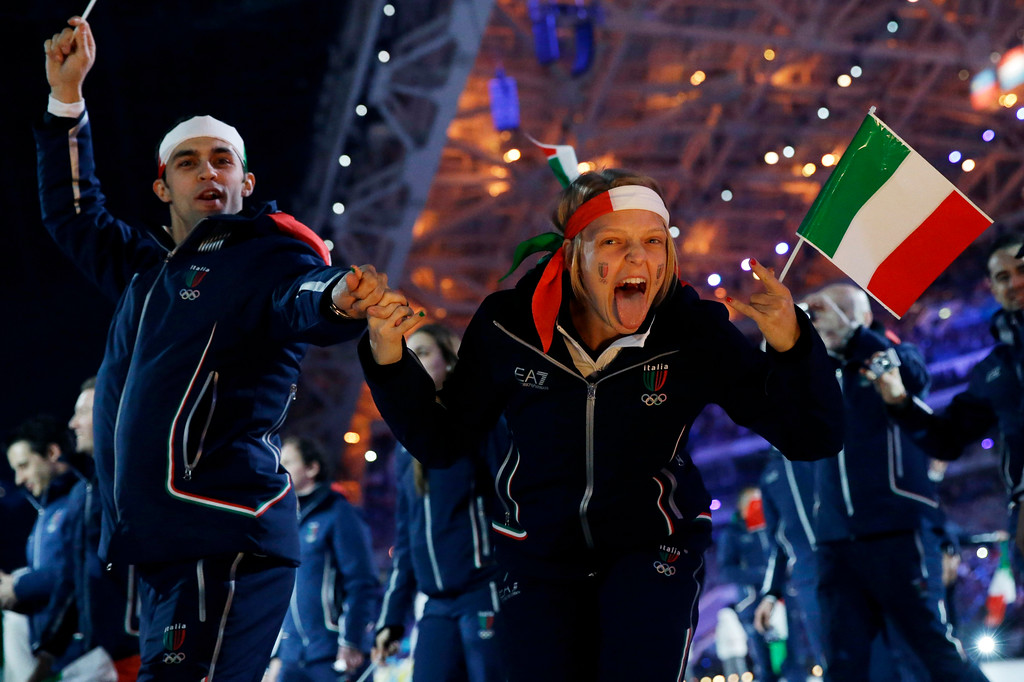 . Members of the Italian team cheer as they enter the stadium during the opening ceremony of the 2014 Winter Olympics in Sochi, Russia, Friday, Feb. 7, 2014. (AP Photo/Patrick Semansky)