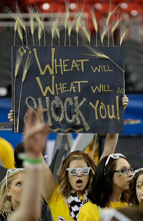 . Fans cheer before the first half of the NCAA Final Four tournament college basketball semifinal game between Louisville and Wichita State, Saturday, April 6, 2013, in Atlanta. (AP Photo/Charlie Neibergall)