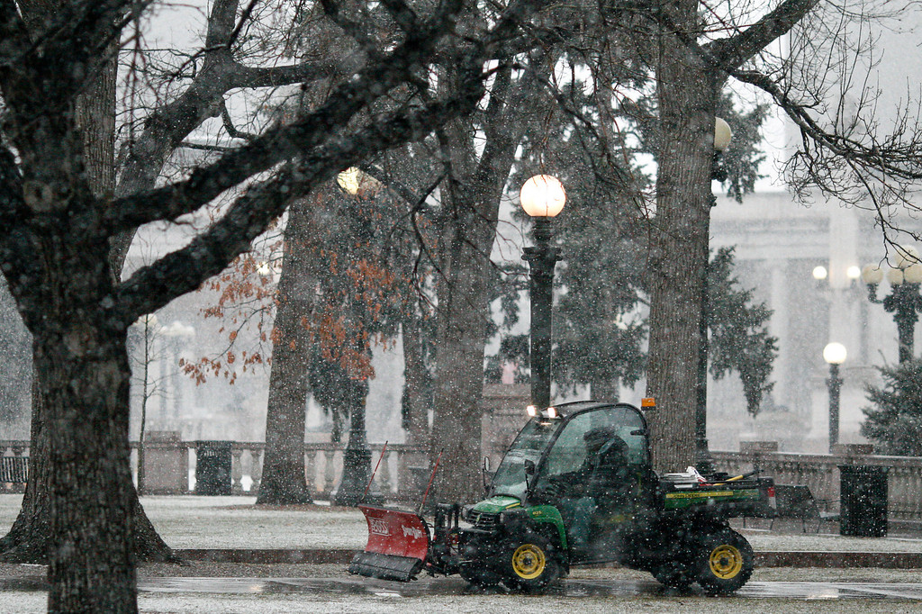 . A groundskeeper prepares to maintain walkways in Denver\'s Civic Center as snow begins to stick to unpaved surfaces Saturday, March 9, 2013. As much as 16 inches of snow is predicted for the Denver metro area. Daniel J. Schneider, The Denver Post