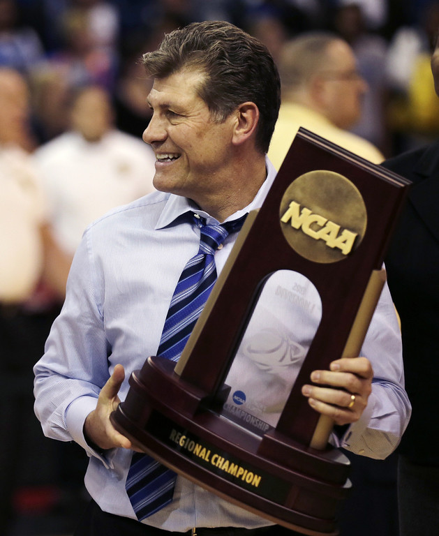 . Connecticut head coach Geno Auriemma smiles after beating Kentucky in the women\'s NCAA regional final basketball game in Bridgeport, Conn., Monday, April 1, 2013. Connecticut won 83-53 and advances to the Final Four. (AP Photo/Charles Krupa)