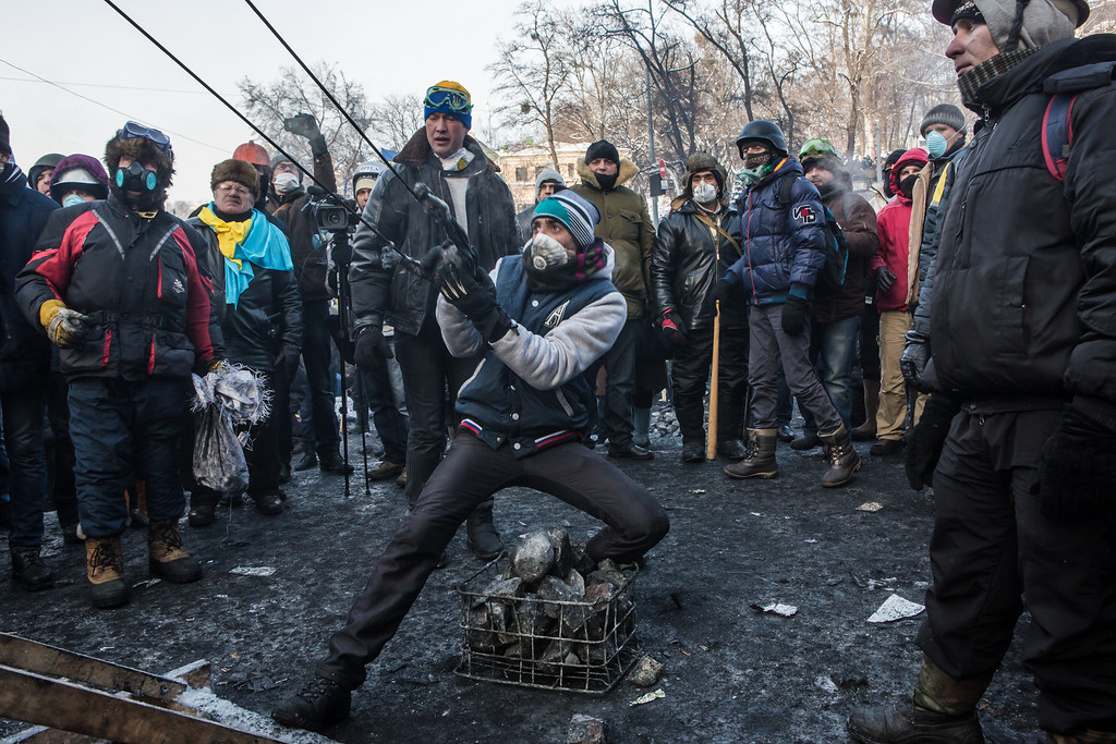 . An anti-government protester uses a large sling shot during clashes with police on Hrushevskoho Street near Dynamo stadium on January 25, 2014 in Kiev, Ukraine. After two months of primarily peaceful anti-government protests in the city center, new laws meant to end the protest movement have sparked violent clashes in recent days. (Photo by Brendan Hoffman/Getty Images)