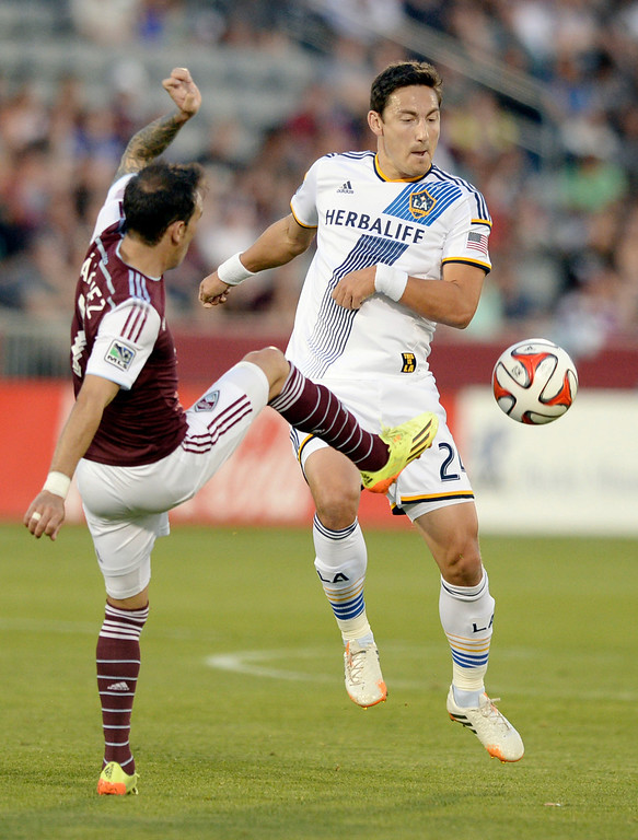 . COMMERCE CITY, CO - MAY 3:  Colorado forward Vicente Sanchez, left, and Los Angeles midfielder Stefan Ishizacki, right, battled for the ball in the first half. The Colorado Rapids hosted the Los Angeles Galaxy Saturday night, May 3, 2014 at Dick\'s Sporting Good Park. (Photo by Karl Gehring/The Denver Post)
