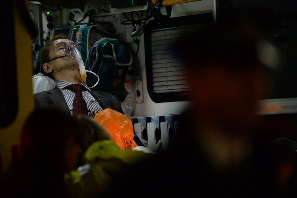 . An injured man is treated inside an ambulance following a ceiling collapse at a theatre in Central London on December 19, 2013.    AFP PHOTO/LEON NEAL/AFP/Getty Images