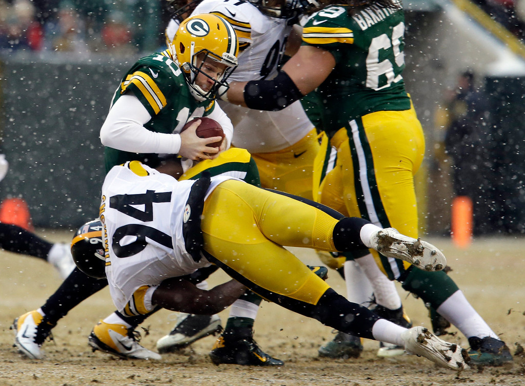 . Green Bay Packers quarterback Matt Flynn is sacked by Pittsburgh Steelers\' Lawrence Timmons (94) during the first half of an NFL football game Sunday, Dec. 22, 2013, in Green Bay, Wis. (AP Photo/Mike Roemer)