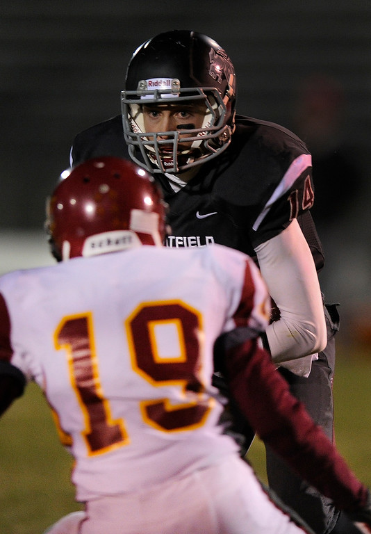 . Chatfield receiver Brandon Zanier (14) kept his eyes locked on Lobos safety David Crawford (19) on the way to a touchdown in the first half. The Chatfield High School football team defeated Rocky Mountain 35-12 at Jefferson County Stadium Thursday night, October 31, 2013. Photo By Karl Gehring/The Denver Post