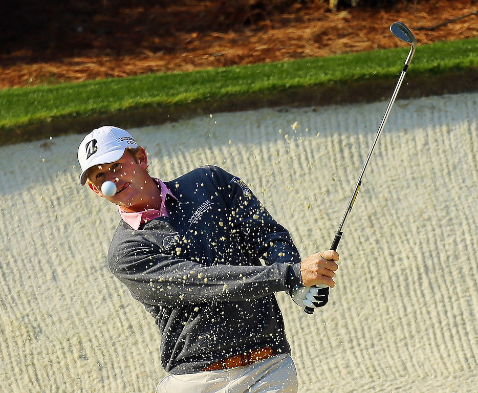 . Brandt Snedeker has his eyes on the ball as he hits from the sand trap to the No. 13 green during a practice round for the Masters golf tournament, Wednesday, April 9, 2014 in Augusta, Ga.  (AP Photo/Atlanta Journal-Constitution, Curtis Compton)