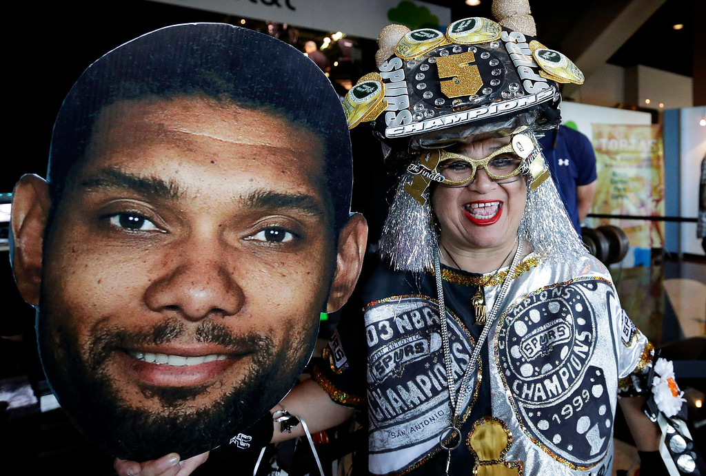 . Sobia Lauriano brings cutout of San Antonio Spurs\' Tim Duncan for Game 5 of the NBA basketball finals against the Miami Heat on Sunday, June 15, 2014, in San Antonio. (AP Photo/David J. Phillip)
