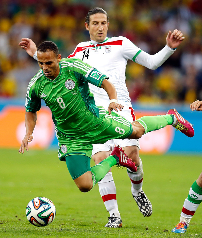 . Nigeria\'s Peter Odemwingie is tripped by Iran\'s Andranik Teymourian during the group F World Cup soccer match between Iran and Nigeria at the Arena da Baixada in Curitiba, Brazil, Monday, June 16, 2014.  (AP Photo/Frank Augstein)