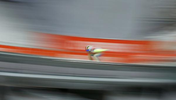 PHOTOS: Men's Ski Jump Normal Hill Qualifications at Sochi Olympics