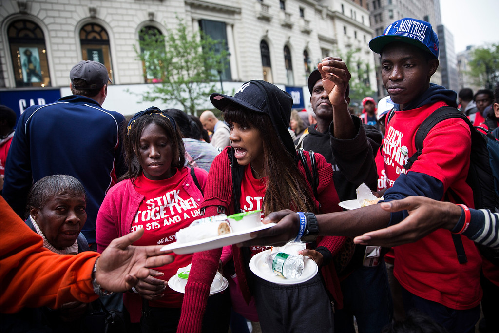 . Protesters demanding higher wages for fast food workers are handed plated lunches during a massive rally on May 15, 2014 in New York City. The lunch consisted of half a sandwich, chips and a bottle of water.   (Photo by Andrew Burton/Getty Images)