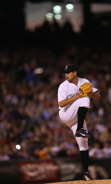 . DENVER, CO - MAY 02:  Starting pitcher Jorge De La Rosa #29 of the Colorado Rockies works against the New York Mets as he earned the win in the 10-3 Rockies victory at Coors Field on May 2, 2014 in Denver, Colorado.  (Photo by Doug Pensinger/Getty Images)
