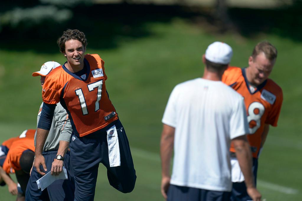 . Denver Broncos quarterback Brock Osweiler (17) stretches before practice  September 3, 2013 at Dove Valley. (Photo by John Leyba/The Denver Post)