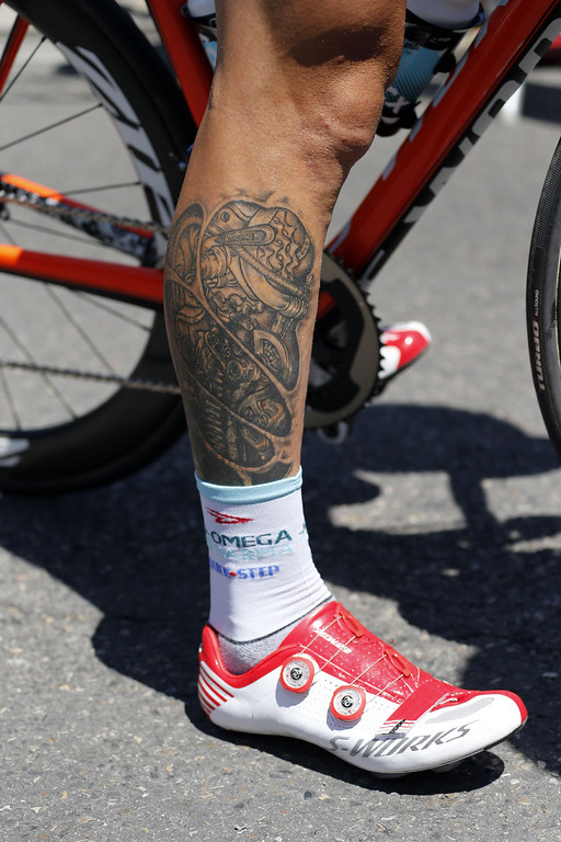 . A tatoo is seen on the leg of Omega Pharma - Quick Step\'s France\'s Sylvain Chavanel as he waits for the start of the 176.5 km sixth stage of the 100th edition of the Tour de France cycling race on July 4, 2013 between Aix-en-Provence and Montpellier, southern France. JOEL SAGET/AFP/Getty Images