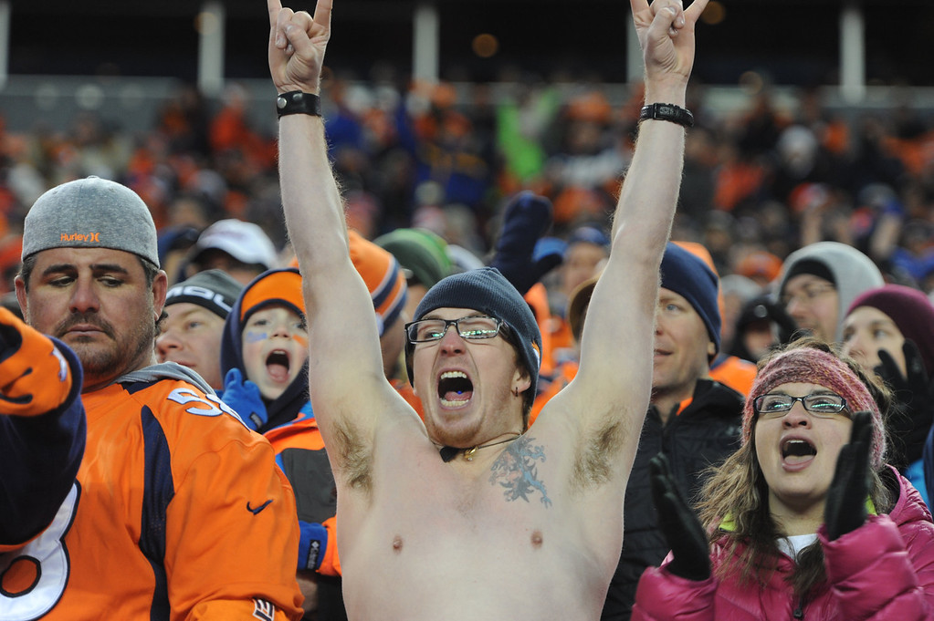 . Tony Barton cheers for the Broncos in the fourth quarter. The Denver Broncos take on the San Diego Chargers at Sports Authority Field at Mile High in Denver on January 12, 2014. (Photo by Craig F. Walker/The Denver Post)