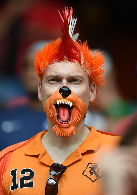 . A fan of the Netherlands looks on before a Group B football match between Spain and the Netherlands at the Fonte Nova Arena in Salvador during the 2014 FIFA World Cup on June 13, 2014.  AFP PHOTO / JAVIER  SORIANO/AFP/Getty Images