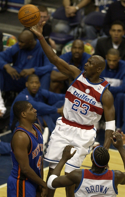 . Washington Wizards\' Michael Jordan (23) goes to the basket against New York Knicks\' Kurt Thomas, left, during first-half action, Monday, April 14, 2003, in Washington. The Wizards were wearing replica Washington Bullets uniforms to honor the 25th anniversary of their last NBA title. It was Michael Jordan\'s last home game.(AP Photo/Nick Wass)