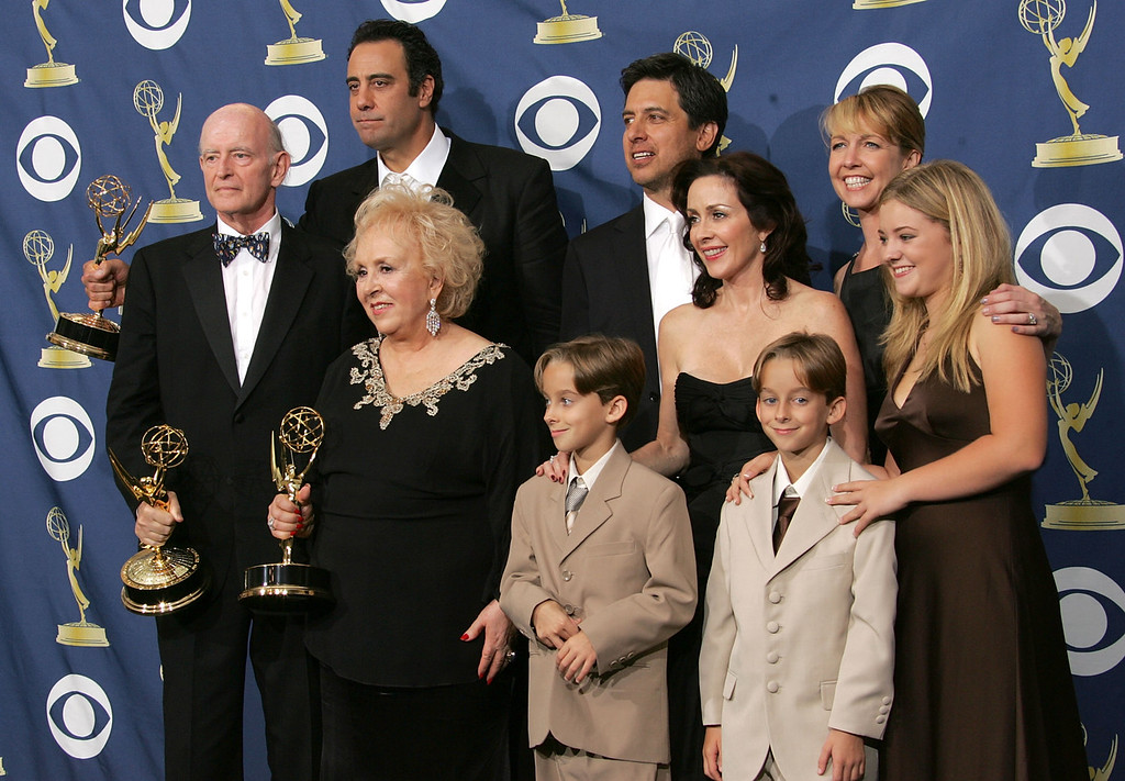 . The cast of Everybody Loves Raymond poses with the Emmy for Outstanding Comedy Series in the press room at the 57th Annual Emmy Awards held at the Shrine Auditorium on September 18, 2005 in Los Angeles, California.  (Photo by Kevin Winter/Getty Images)