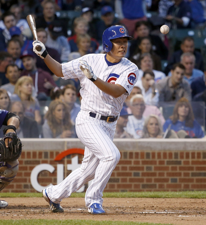 . Chicago Cubs\' Tsuyoshi Wada fouls off a pitch from Colorado Rockies starting pitcher Yohan Flande during the third inning of a baseball game Monday, July 28, 2014, in Chicago. (AP Photo/Charles Rex Arbogast)