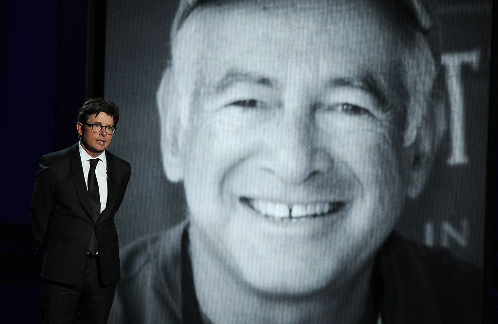 . Michael J. Fox presents a tribute to Gary David Goldberg at the 65th Primetime Emmy Awards at Nokia Theatre on Sunday Sept. 22, 2013, in Los Angeles.  (Photo by Chris Pizzello/Invision/AP)