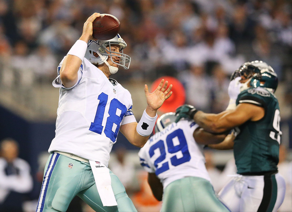 . Kyle Orton #18 of the Dallas Cowboys looks to pass in the first half against the Philadelphia Eagles at Cowboys Stadium on December 29, 2013 in Arlington, Texas.  (Photo by Ronald Martinez/Getty Images)