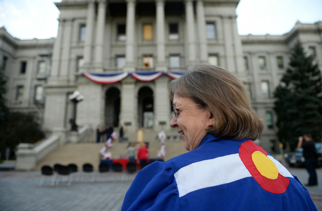 . Square dancer Barbara Meachum, in her homemade Colorado dress, celebrate 138th anniversary of the state of Colorado on the west steps of Colorado State Capitol in Denver, August 01, 2014. The celebration included dancing, a cake, a performance from the Colorado Army National Guard Band, and more. (Photo by RJ Sangosti/The Denver Post)