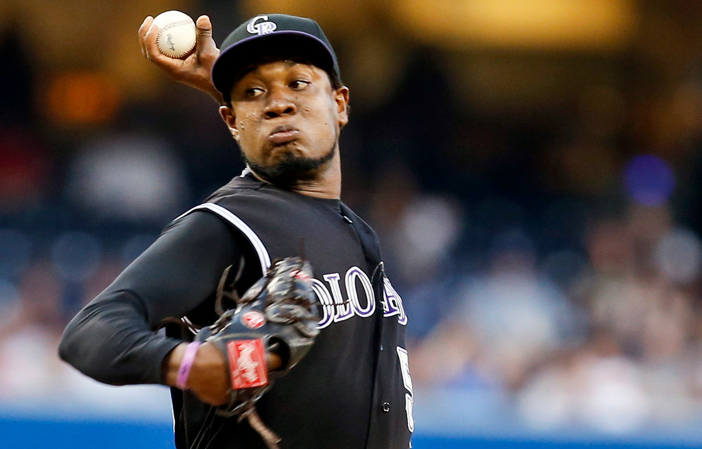 . Colorado Rockies starting pitcher Yohan Flande works against the San Diego Padres in the first inning of a baseball game Tuesday, Aug. 12, 2014, in San Diego. (AP Photo/Lenny Ignelzi)