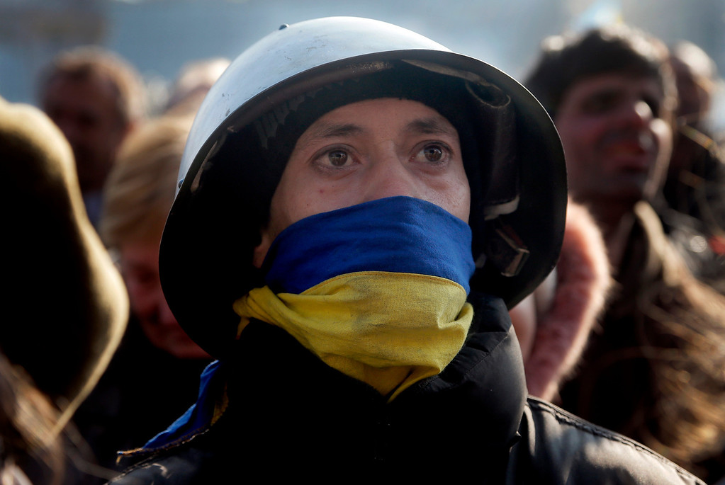 . A protester looks on during a rally in Independence Square, the epicenter of the country\'s current unrest, in Kiev, Ukraine, Friday, Feb. 21, 2014. (AP Photo/Efrem Lukatsky)
