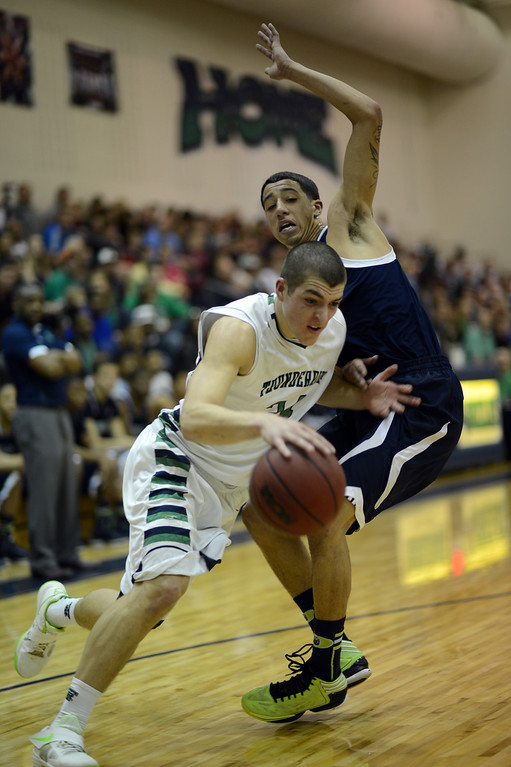 . HIGHLANDS RANCH, CO. - MARCH 02: Zach Rusk of ThunderRidge High School #24 drives and past Taren Williams of Overland High School #2 during the 2nd round of 5A playoff game at ThunderRidge High School. March 2, 2013. Highlands Ranch, Colorado. ThunderRidge won 67-57. (Photo By Hyoung Chang/The Denver Post)