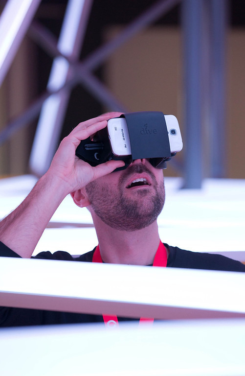 ". A man looks at 3D pictures on a smartphone with the ""Dive\"" adapter at CeBIT 2014 at the convention center in Hanover, Germany, 08 March 2014. The world\'s largest computer expo CeBIT�will officially open on 09 March.  EPA/Friso Gentsch"