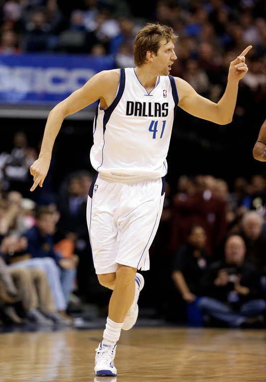 . Dallas Mavericks power forward Dirk Nowitzki (41), of Germany, gestures to a teammate after scoring a basket in the first half of an NBA basketball game against the Denver Nuggets, Friday, Dec. 28, 2012, in Dallas. The game is Nowitzki\'s first at home this season since returning from knee surgery. (AP Photo/Tony Gutierrez)
