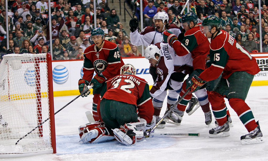 . Colorado Avalanche right wing Steve Downie (C) celebrates as teammate Avalanche center John Mitchell (7) scores a goal against Minnesota Wild goalie Niklas Backstrom (32) during the first period of their NHL hockey game in St. Paul, Minnesota, January 19, 2013. REUTERS/Eric Miller