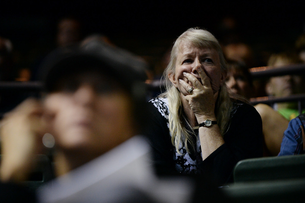 . LOVELAND, CO - September 20 : Evacuee Karen Nutter from Big Thompson valley reacts after seeing slide show of damaged areas during the evacuee meeting at the Budweiser Event Center. Loveland, Colorado. September 20, 2013. The Larimer County Sheriff\'s Office in coordination with multiple federal, state, county and local agencies as well as several charitable organizations held an evacuee informational meeting. (Photo by Hyoung Chang/The Denver Post)