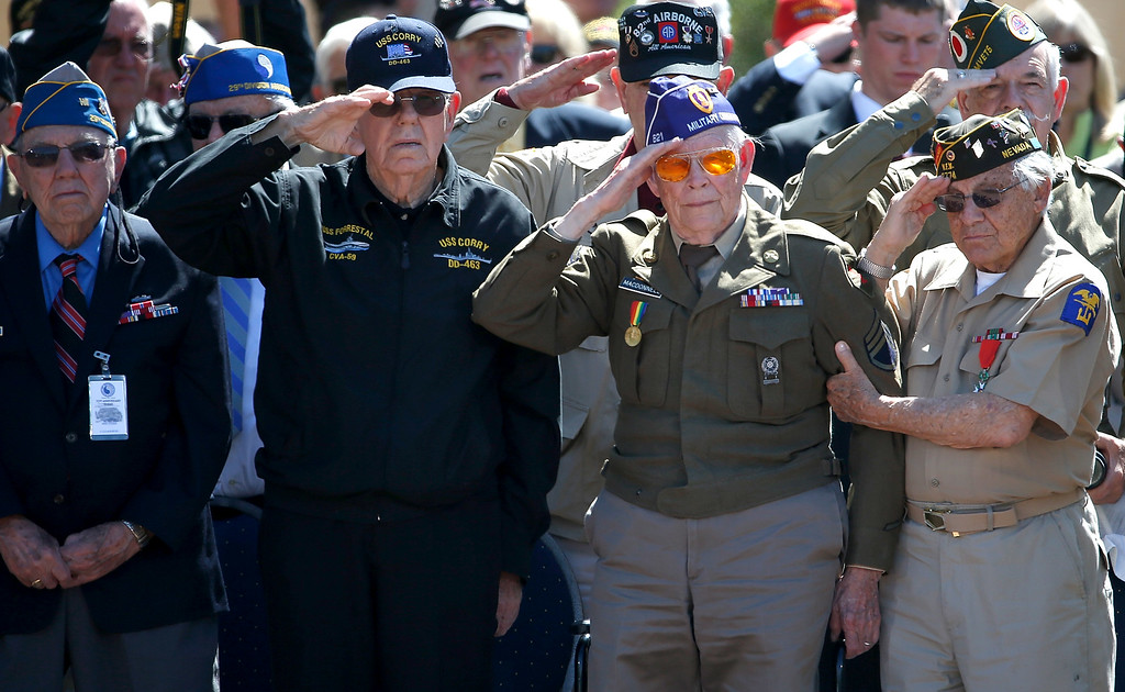 ". WWII Veterans salute during the playing of ""Taps\"" at a ceremony with U.S. President Barack Obama at the Normandy American Cemetery on the 70th anniversary of D-Day June 6, 2014 in Colleville-sur-Mer, France.   (Photo by Win McNamee/Getty Images)"