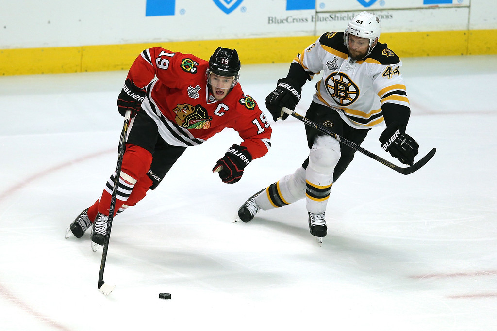 . CHICAGO, IL - JUNE 22:  Jonathan Toews #19 of the Chicago Blackhawks skates with the puck agianst Dennis Seidenberg #44 of the Boston Bruins in Game Five of the 2013 NHL Stanley Cup Final at United Center on June 22, 2013 in Chicago, Illinois.  (Photo by Jonathan Daniel/Getty Images)